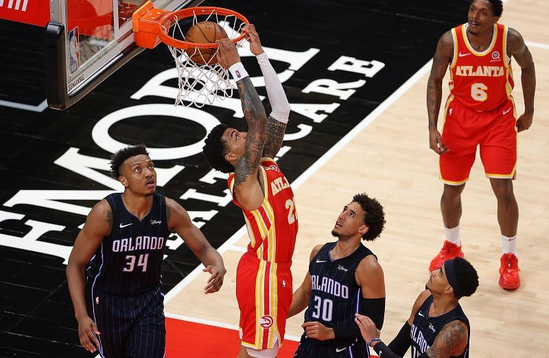 John Collins finishes a dunk