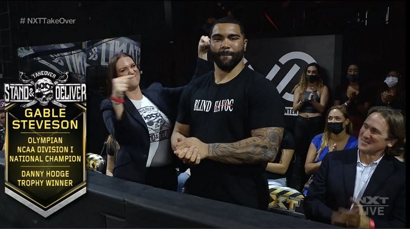 Gable Steveson alongside Stephanie McMahon at NXT TakeOver: Stand & Deliver.