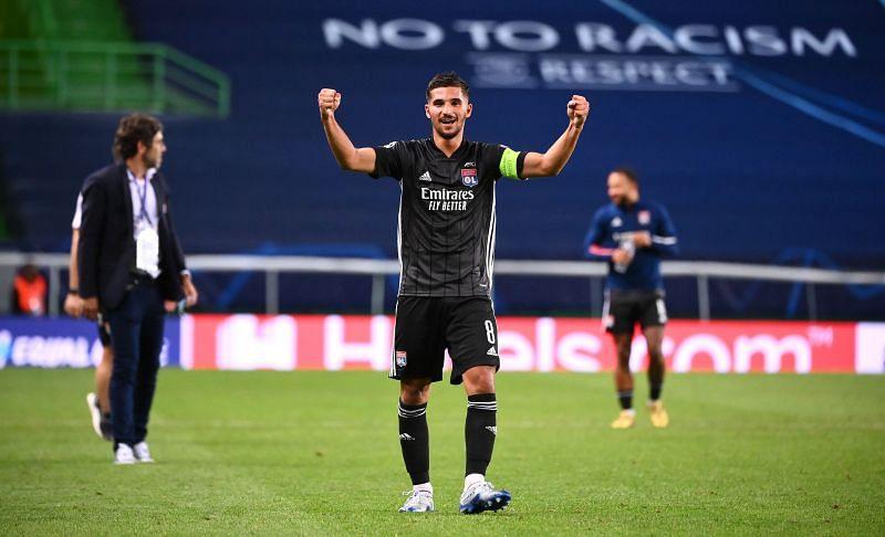 Houssem Aouar celebrates a win with Lyon