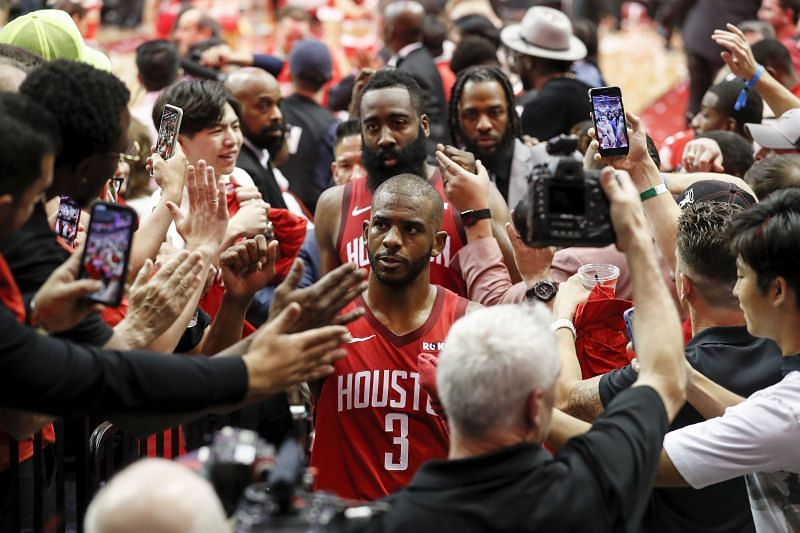 Chris Paul #3 and James Harden #13 walk to the locker room after a playoff game in 2019.