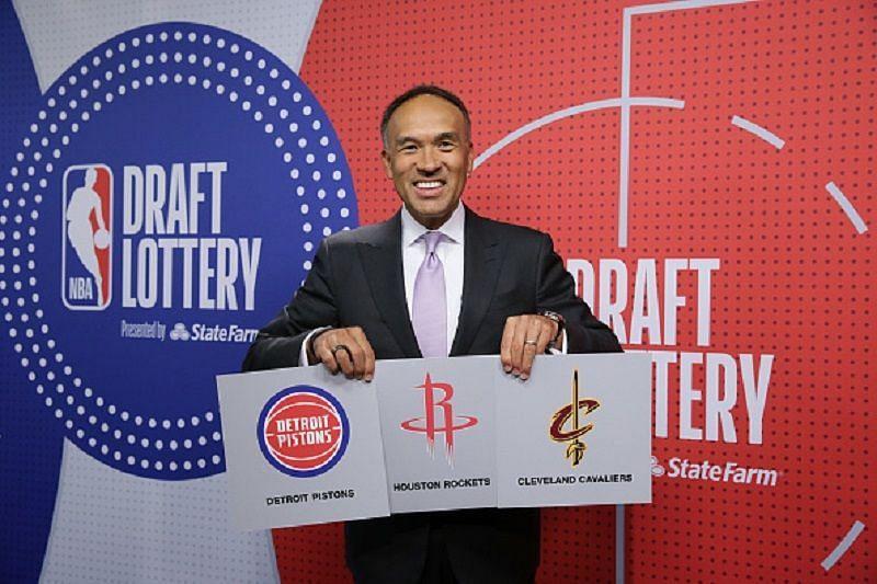 NBA Deputy Commission Mark Tatum with the winners of the top three picks