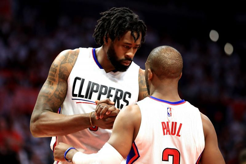 DeAndre Jordan #6 talks with Chris Paul #3 during the second half of a Game 7.