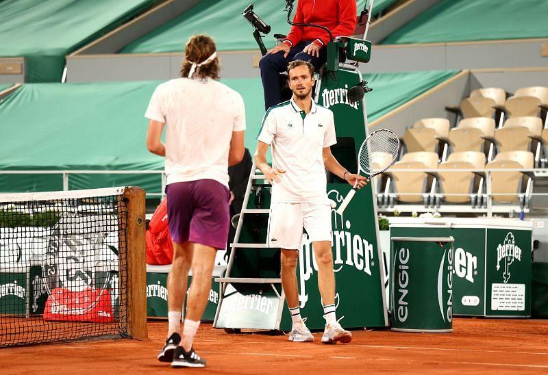 Stefanos Tsitsipas (L) and Daniil Medvedev after their quarterfinal match at Roland Garros