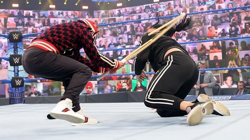 Rey Mysterio attacked Roman Reigns with a kendo stick on WWE SmackDown