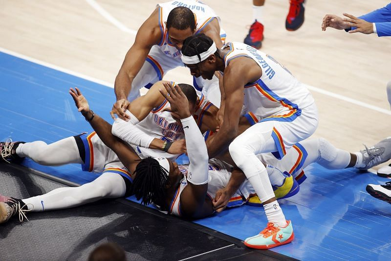 Oklahoma City Thunder players celebrate a game-winner by Luguentz Dort
