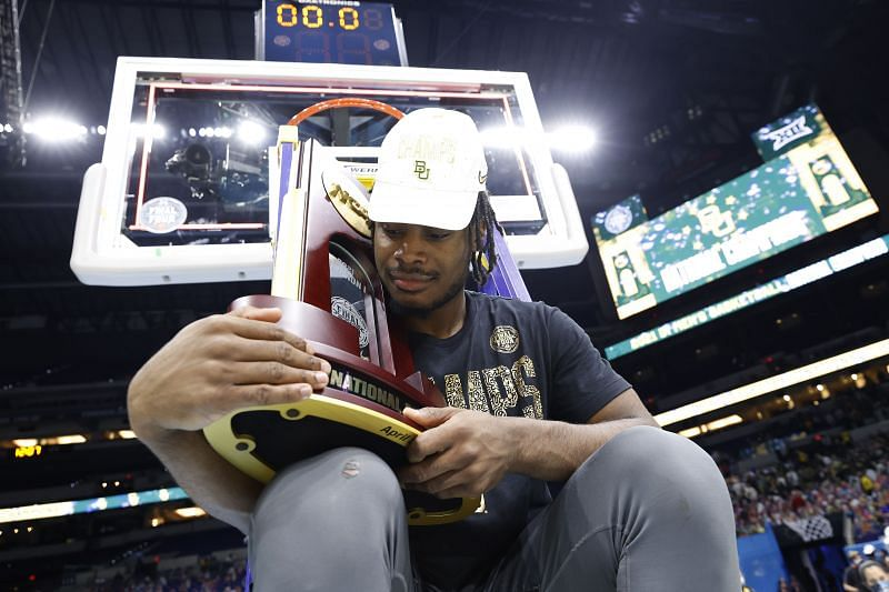 Davion Mitchel of the Baylor Bears holds the 2021 NCAA championship trophy