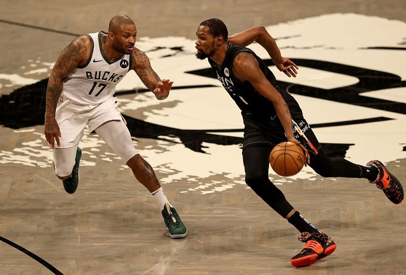 Kevin Durant #7 of the Brooklyn Nets drives past P.J. Tucker #17 of the Milwaukee Bucks