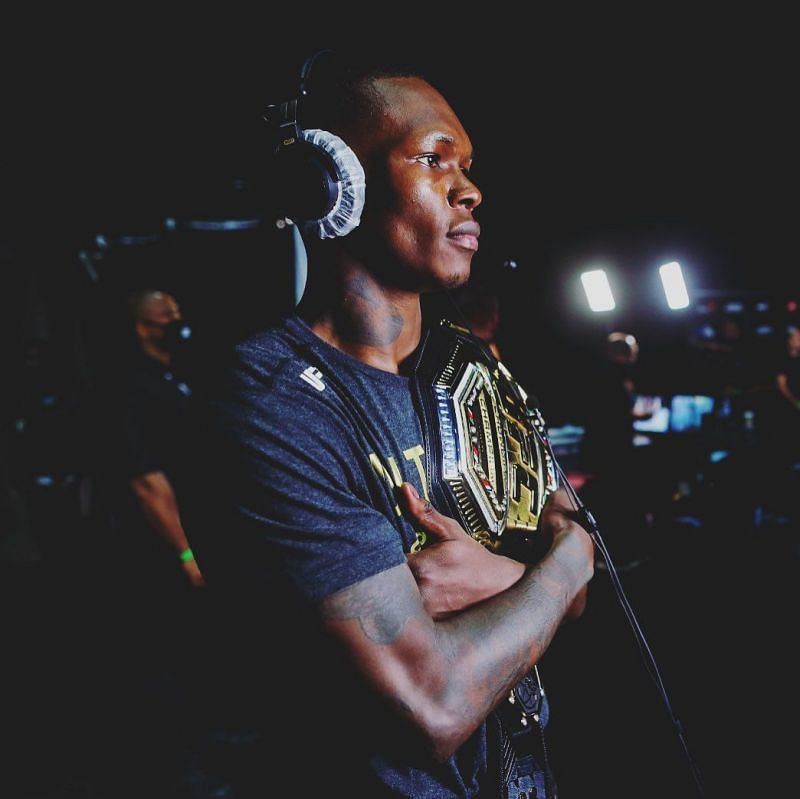 Israel Adesanya with the UFC middleweight belt