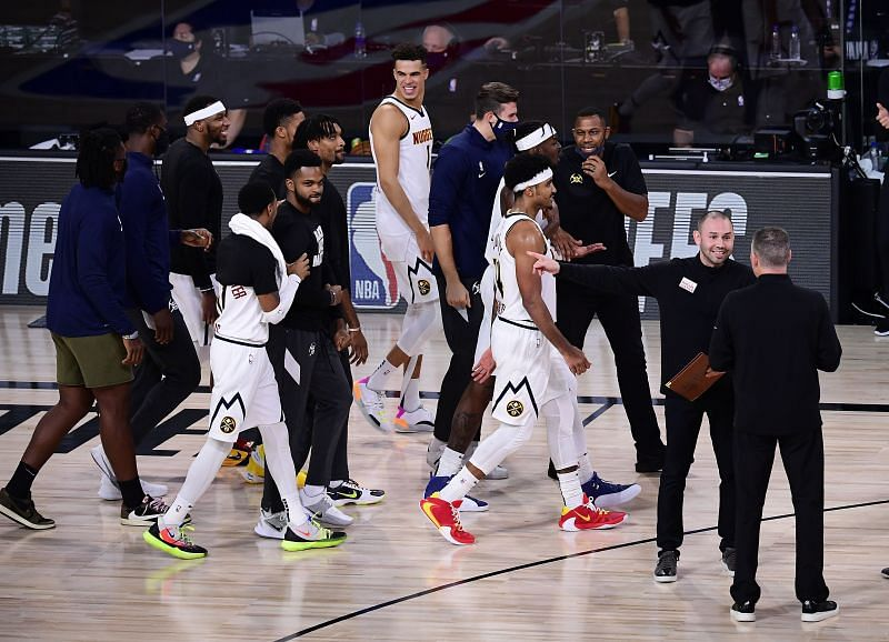 The Denver Nuggets celebrate during the fourth quarter against the LA Clippers in Game Seven of the Western Conference Second Round during the 2020 NBA Playoffs.