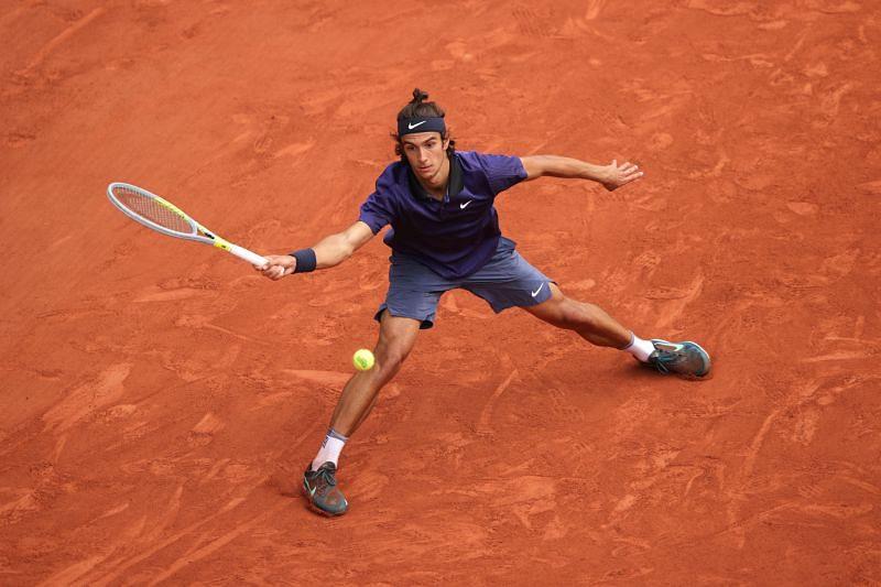 Lorenzo Musetti in action against Novak Djokovic