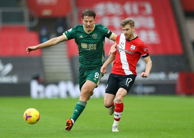 Sander Berge (left) in action for Sheffield during their unsuccessful 2020-21 Premier League campaign