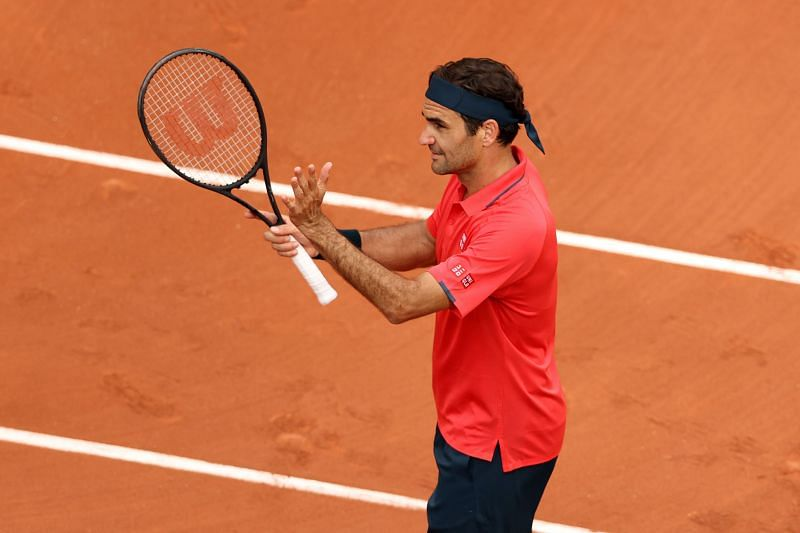 Roger Federer celebrates after reaching the third round at Roland Garros