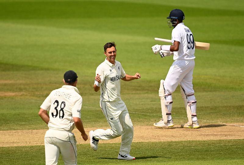 Trent Boult (centre) celebrates R Ashwin