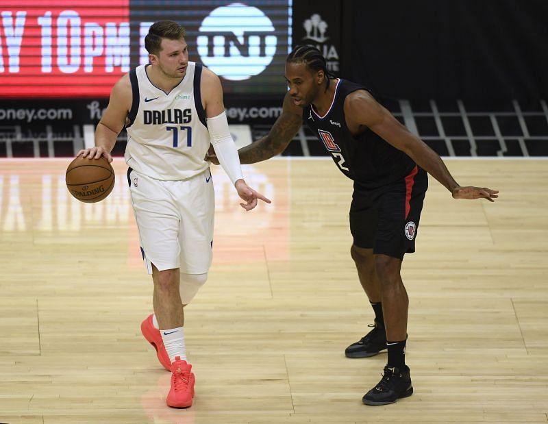 Luka Doncic #77 of the Dallas Mavericks and Kawhi Leonard of the LA Clippers