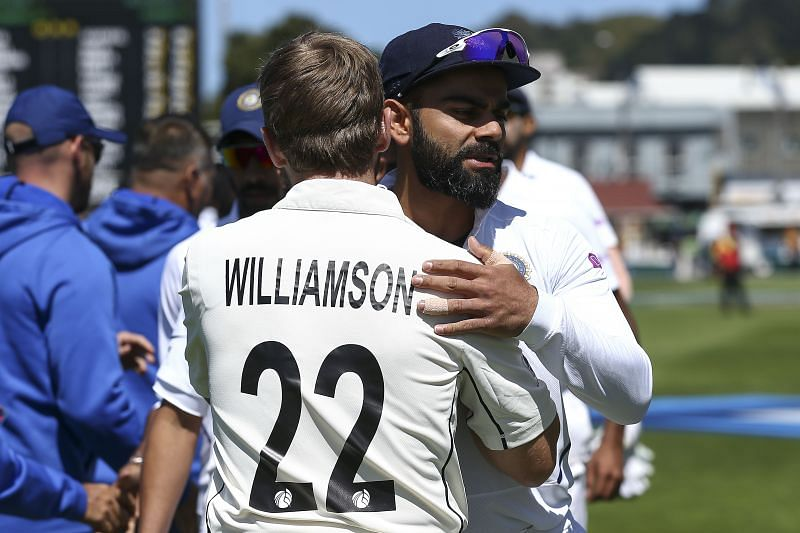 Virat Kohli (right) and Kane Williamson embrace after Day 4 of the First Test between New Zealand and India in 2020