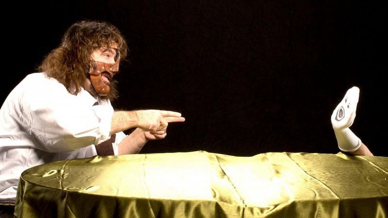 """Mick Foley and his """"Mr. Socko"""" sock puppet"""