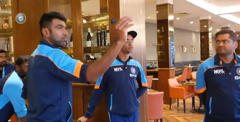 Team India cricketers engage in a game of dart