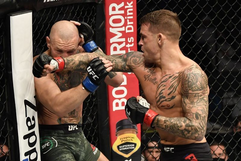 Dustin Poirier works Conor McGregor against the cage