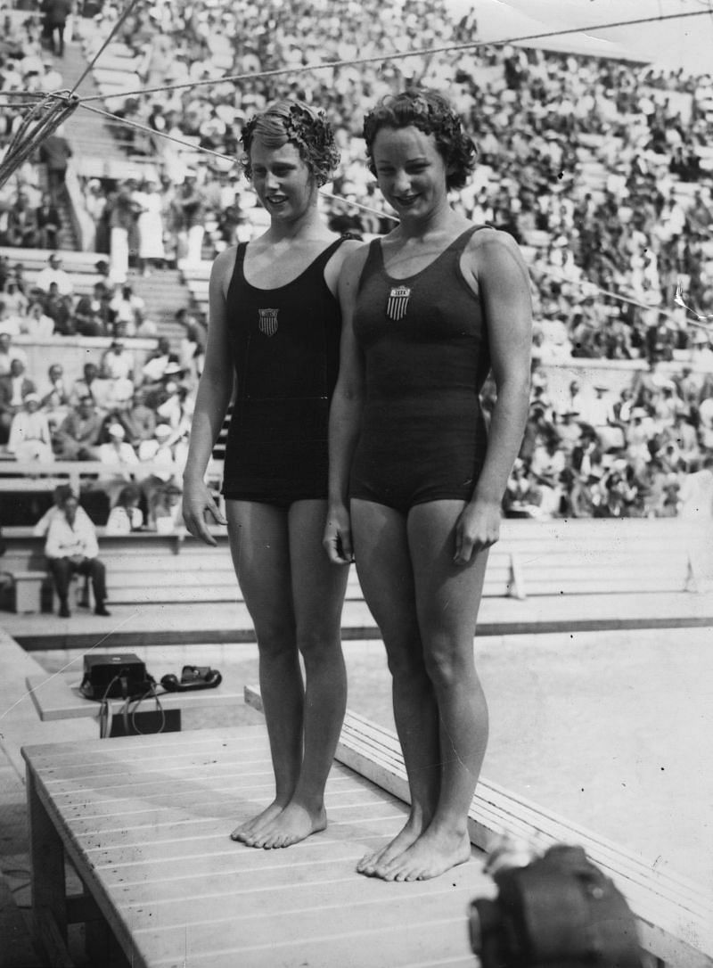 Youngest Olympic gold medalist Marjorie Gestring, 13, with silver medalist Katy Rawls at the Berlin Olympic Swimming Stadium