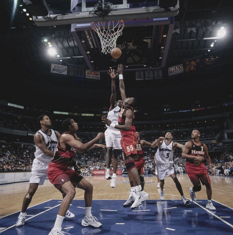 Dikembe Mutombo #55 attempts to block the shot of Rod Strickland.