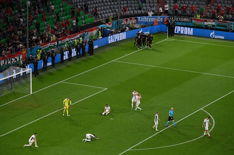 Germany (top centre) celebrate their late equalizer while Hungary players look dejected
