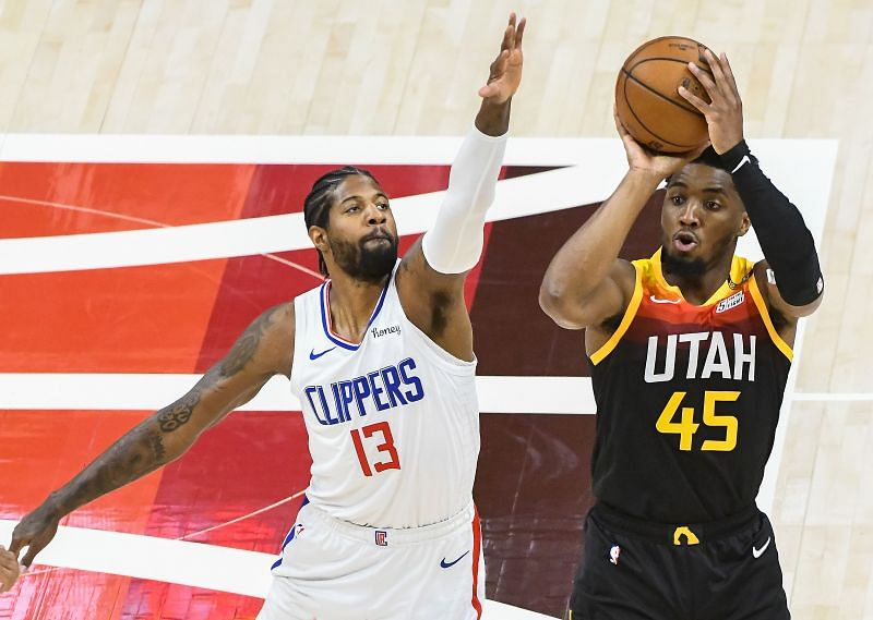 Donovan Mitchell shoots over Paul George