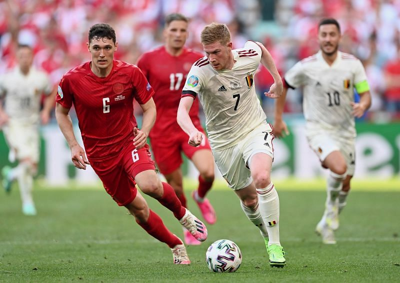 Kevin de Bruyne (right) dribbles past Andreas Christensen (right) during Belgium