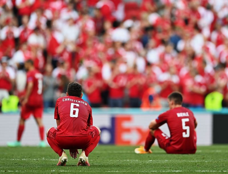 Defenders Andreas Christensen and Joakim Maehle look on in disappointment after Denmark