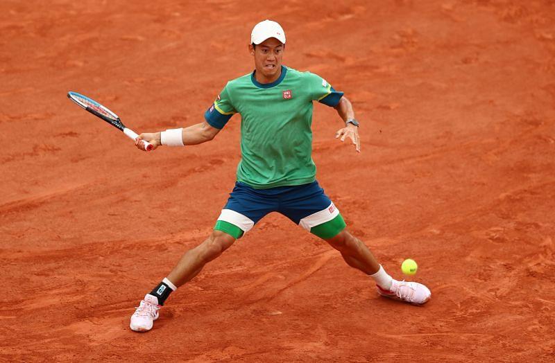Kei Nishikori in action against Henri Laaksonen in the third round of Roland Garros 2021