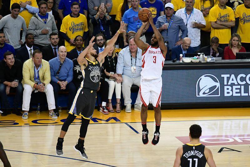 Chris Paul #3 takes a shot against Stephen Curry #30.
