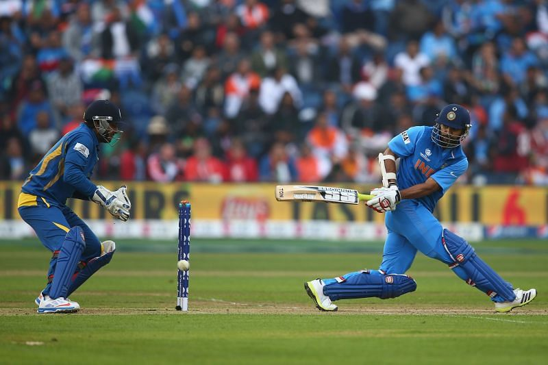 Shikhar Dhawan plays a sweep. Pic: Getty Images