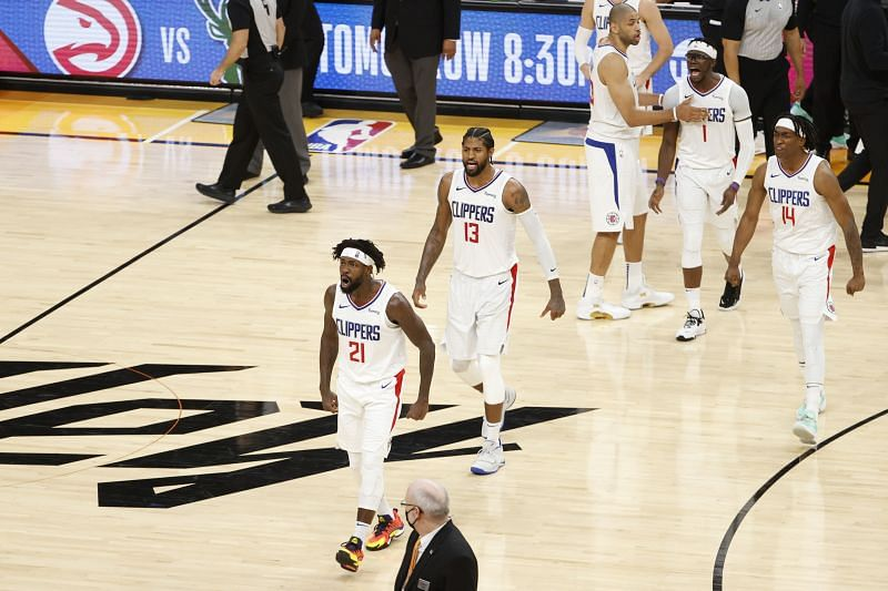 Patrick Beverley #21, Paul George #13, and Terance Mann #14 react during the fourth quarter of Game 2.