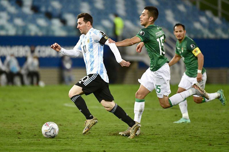 Messi carries the ball forward for Argentina