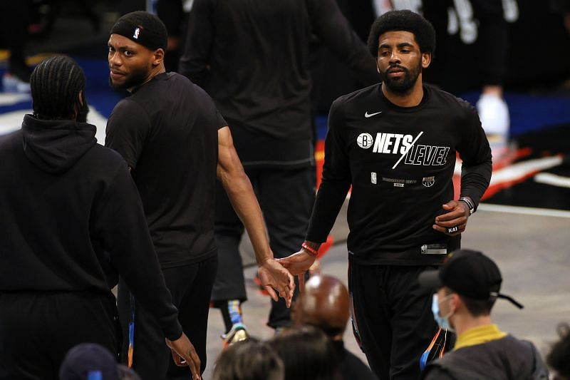 Kyrie Irving (right) of the Brooklyn Nets
