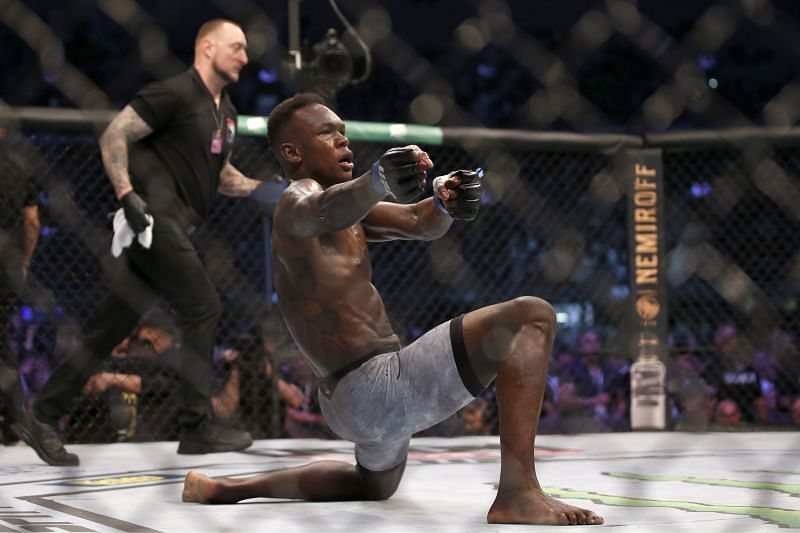 Israel Adesanya celebrates after winning the undisputed UFC middleweight title at UFC 243