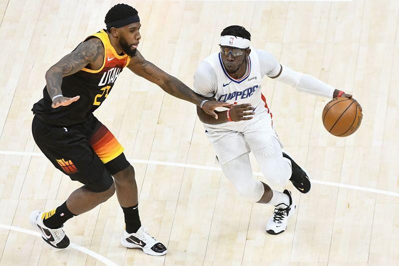 Reggie Jackson dribbles against Royce O