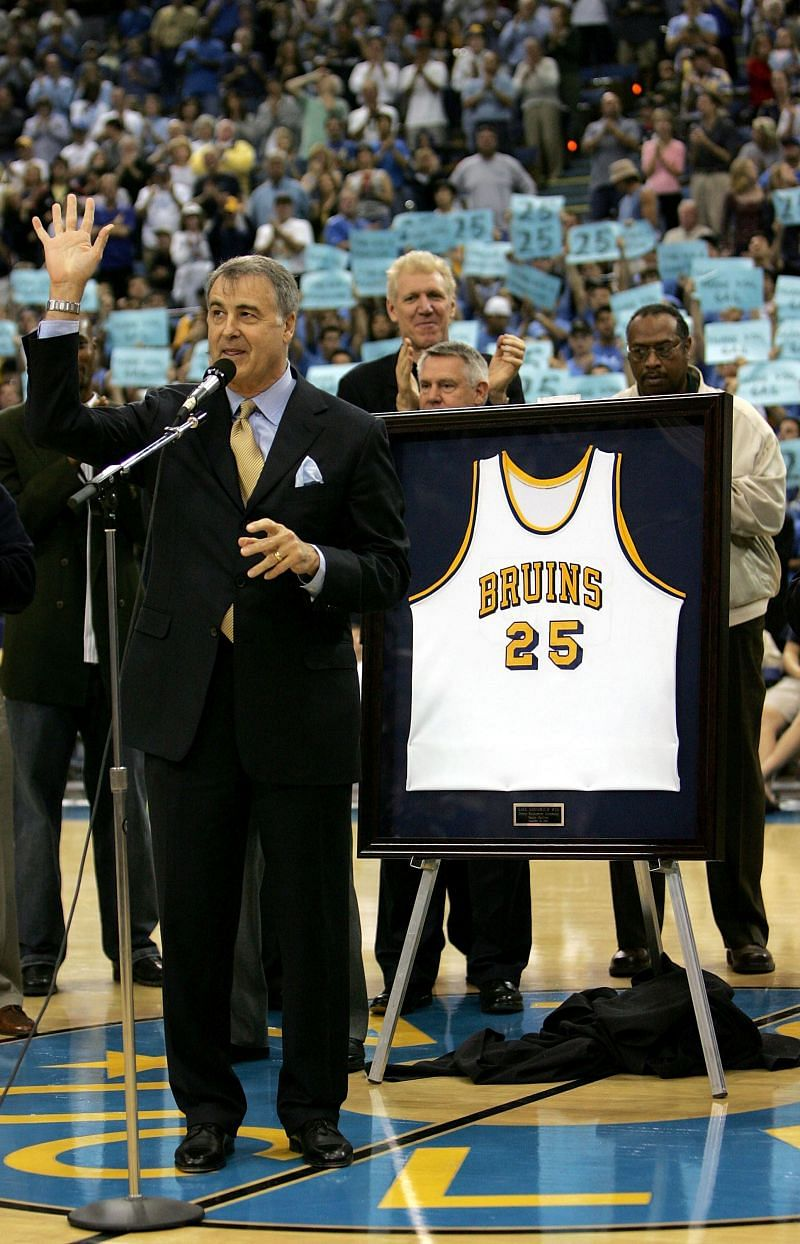 Former UCLA player Gail Goodrich waves to the crowd as his jersey is retired