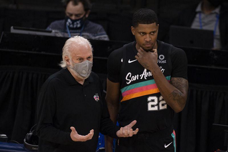 San Antonio Spurs veteran Rudy Gay with coach Gregg Popovich