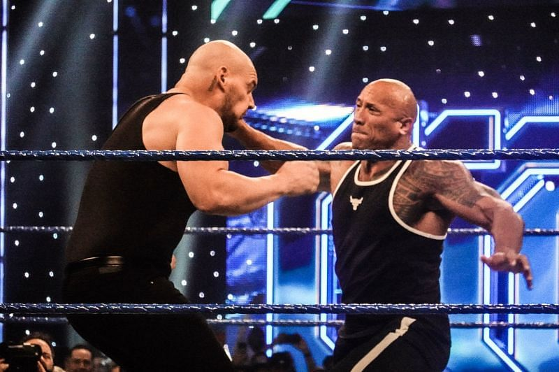 The Rock lands a punch on Baron Corbin