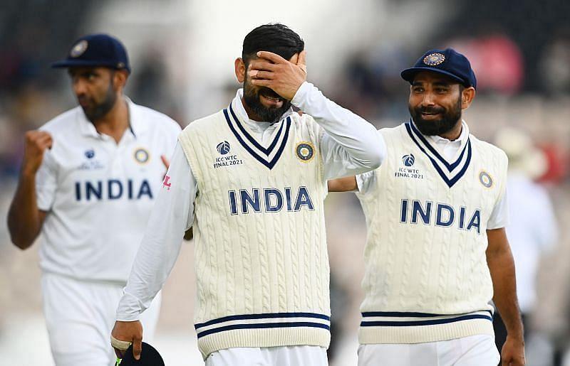 R Ashwin, Virat Kohli and Mohammed Shami (from left to right)