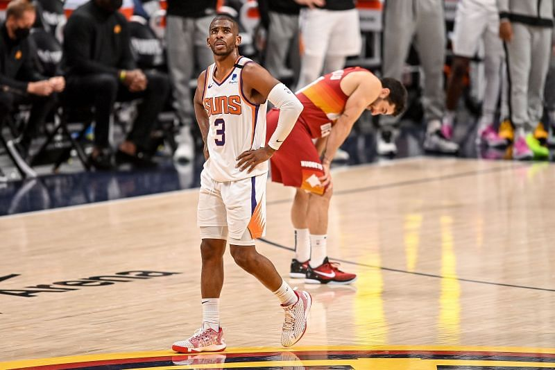 Chris Paul #3 walks on the court as Facundo Campazzo #7.