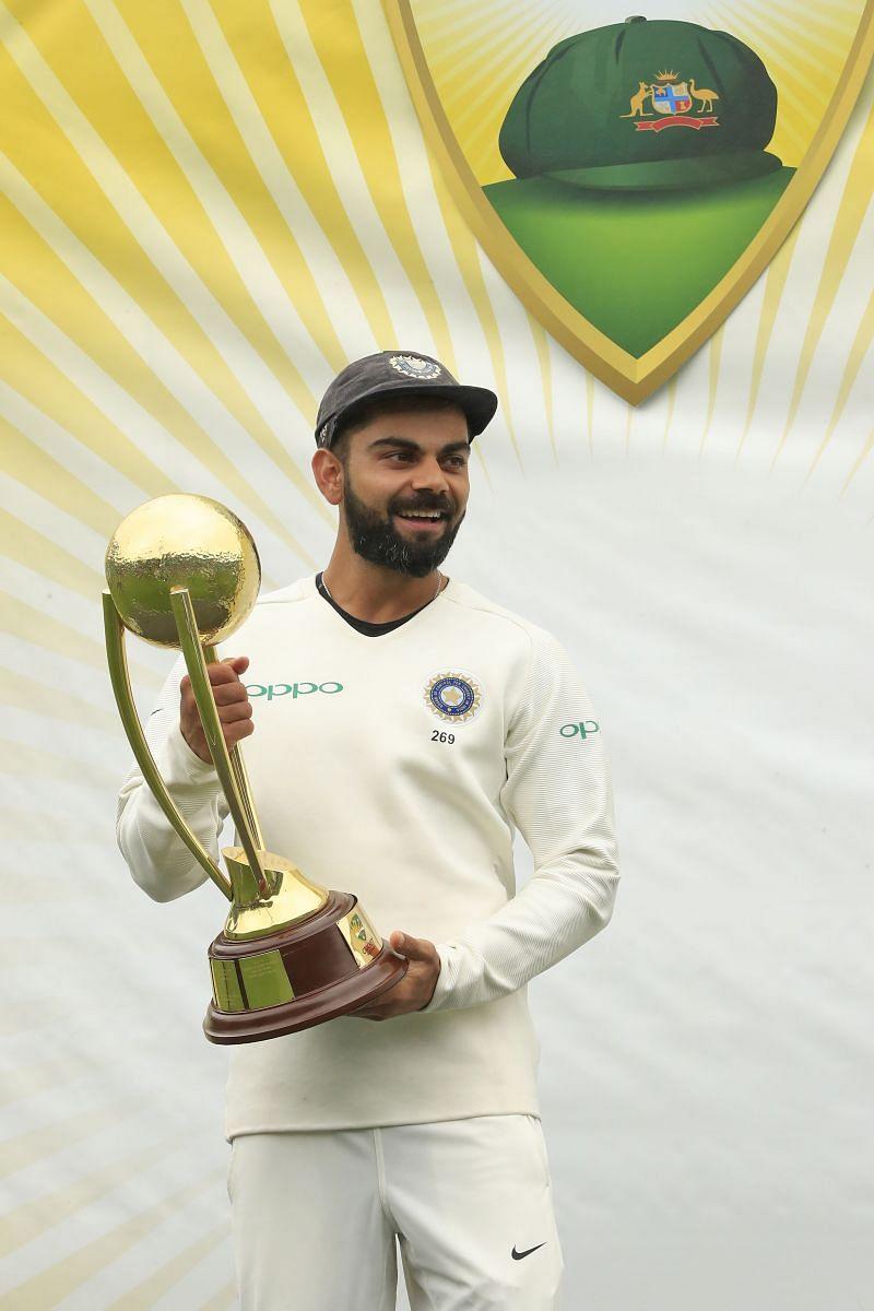 Virat Kohli with the Border-Gavaskar Trophy after a series win in Australia.