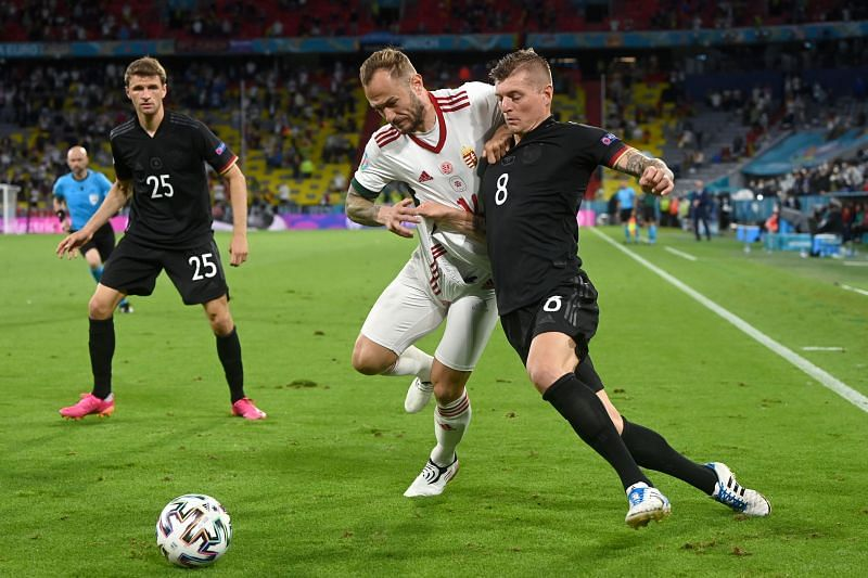 Germany's Toni Kroos tussles it out against Gergo Lovrencsics of Hungary