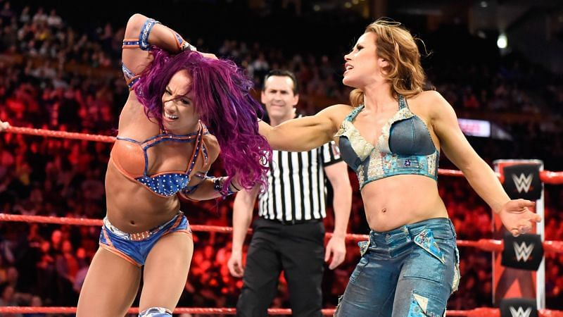 Mickie James and Sasha Banks in the ring