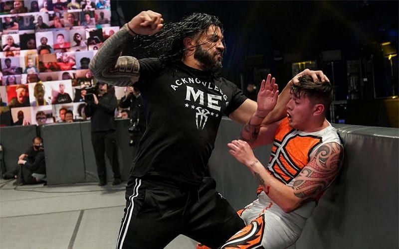 Dominik Mysterio getting assaulted by Roman Reigns