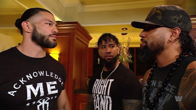 Roman Reigns and Jimmy and Jey Uso