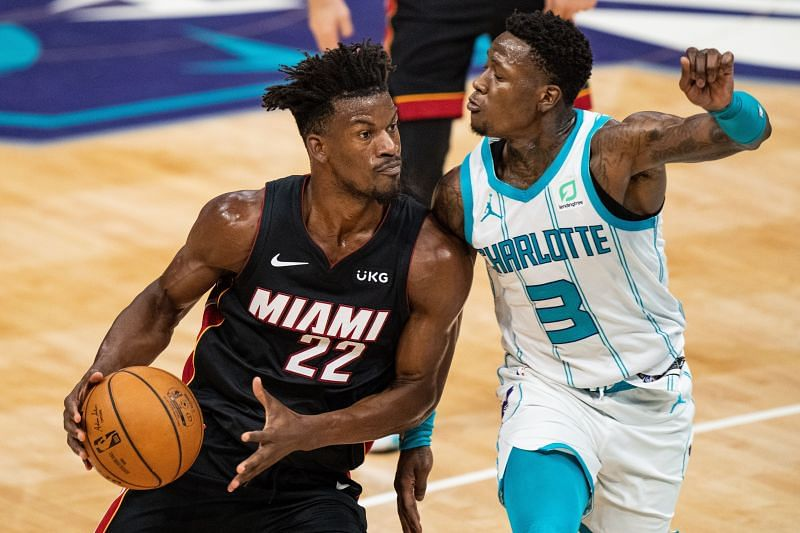 Jimmy Butler #22 drives to the basket while guarded by Terry Rozier #3.