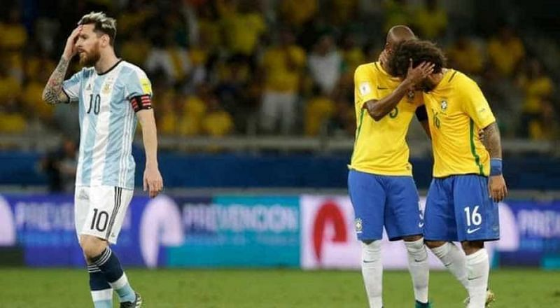 Lionel Messi (left) is distraught after a Brazil goal