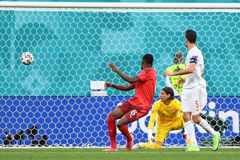 Denis Zakaria (n red) put one through his own net against Spain