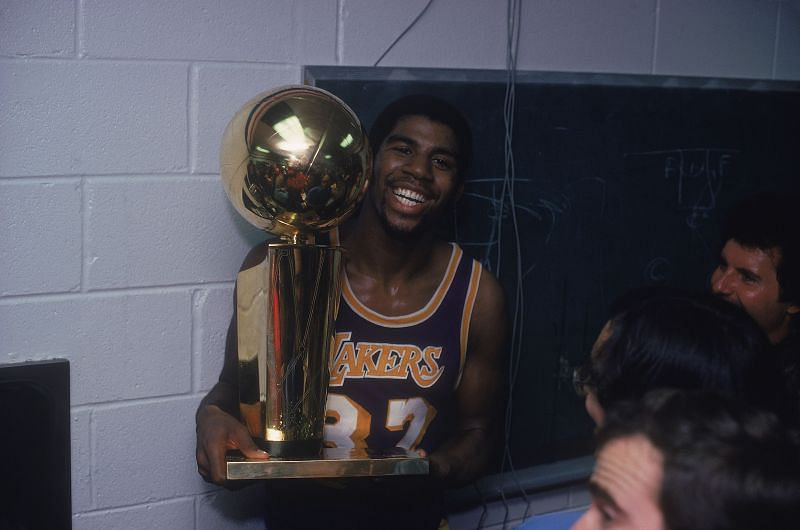 Magic Jonson with the Larry O'Brien trophy. Photo Credit: Focus on Sport via Getty Images.